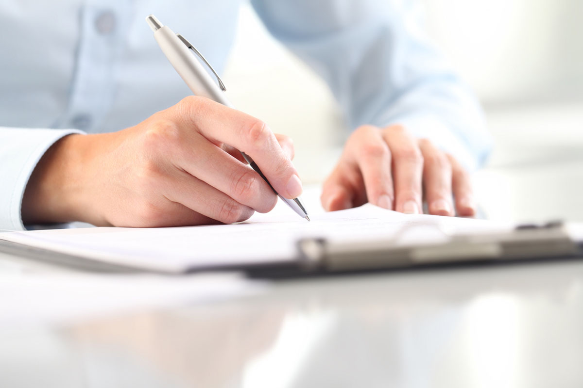 Woman's hands filling in form